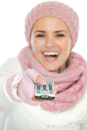 Closeup on TV remote control in hand of woman