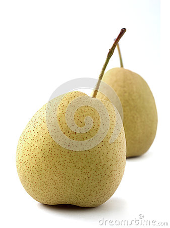 Closeup of two juicy organic pears on white