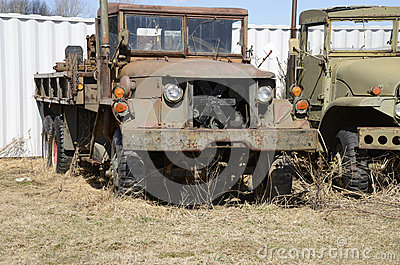 Closeup view of two old army vehicles