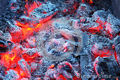 Closeup of warm glowing embers in fireplace