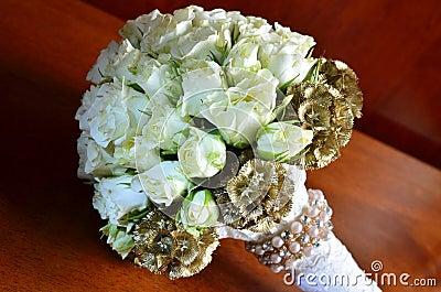 White roses on wedding bouquet