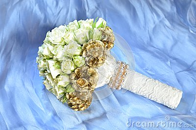 White wedding bouquet against blue background