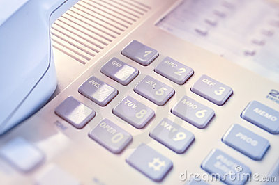 This is closeup of wired desktop telephone