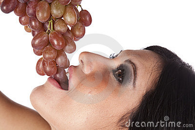 Closeup of woman eating grapes.