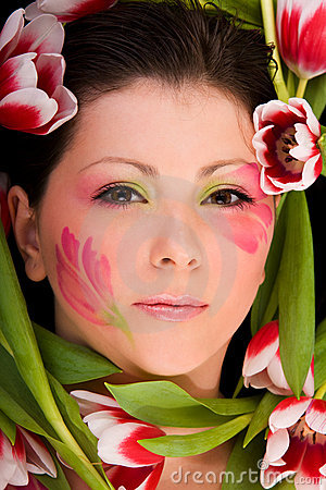 Closeup of woman face framed with tulips