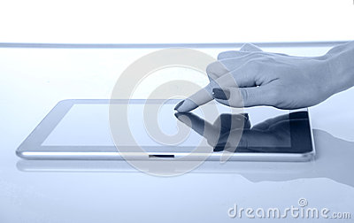 Closeup of woman finger touching tablet pc