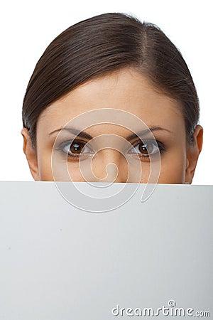 Closeup of a Woman Hiding Behind Billboard
