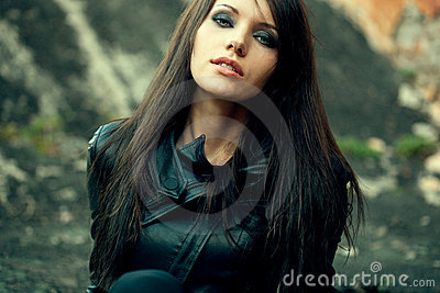 Closeup woman portrait wearing leather jacket