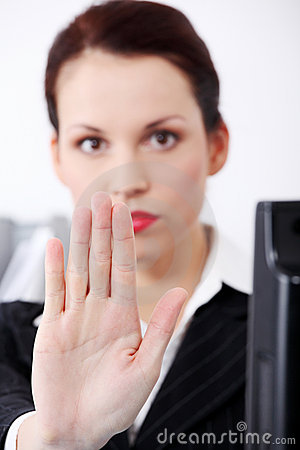 Closeup on woman`s hand gesturing stop.