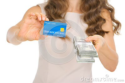 Closeup on woman showing credit card and money pac