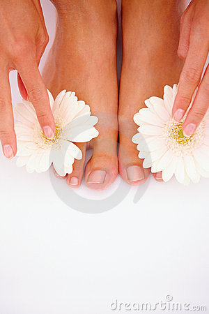Closeup of a young girl placing flowers on toes