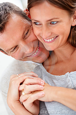 Closeup of a young happy couple holding hands
