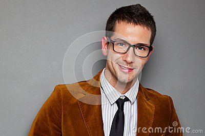 Closeup of young interesting businessman with rimmed glasses