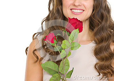 Closeup on young woman with red rose