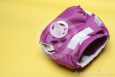 Cloth Diaper with Dummy on Yellow Background
