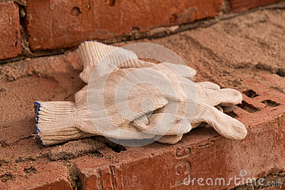Cloth gloves on bricks