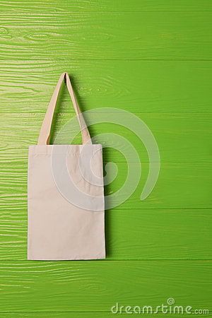Clothes bag on green background