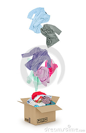 Free Clothes Falling Into The Cardboard Box Royalty Free Stock Photo - 56478965