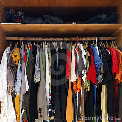 Clothes in full wardrobe