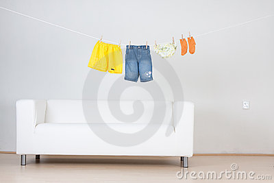 Clothes hanging over couch