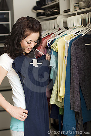 Free Clothes In Closet Stock Photography - 9080822