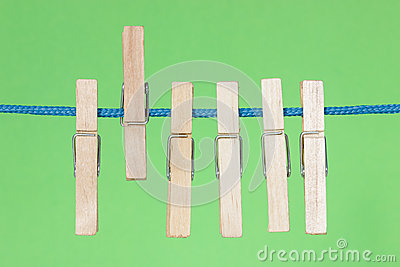 Clothes pegs  on the green background