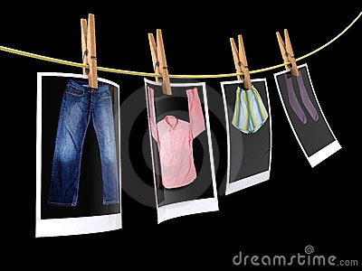 Clothes pin holding photographs