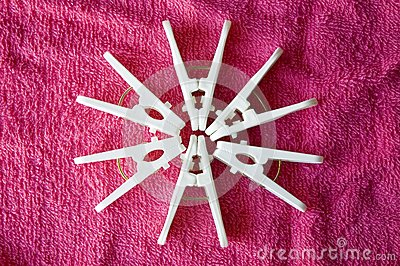 Clothes pins on pink towel