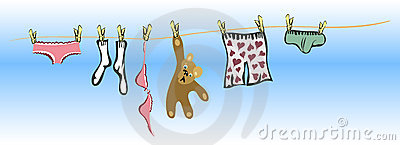 Clothes and teddy bear handing to dry