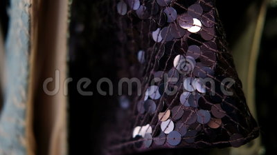 Clothing made from purple sequins hangs on a hanger. stock video footage
