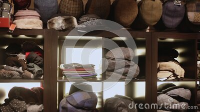 Clothing store showcase with variety of mens flat caps, womens hats and berets. High quality FullHD footage stock footage
