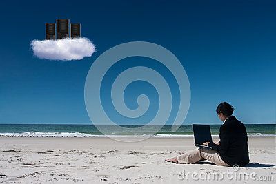 Cloud computing on beach with laptop