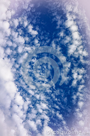 Cloud formations in blue sky