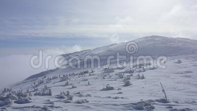 Cloud in the mountains. Timelapse. In sunny winter day stock video footage