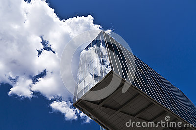 Cloud reflecting on skyscraper