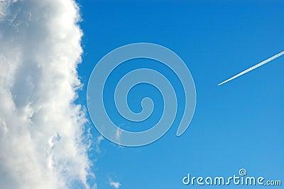 Cloud and smoke trail