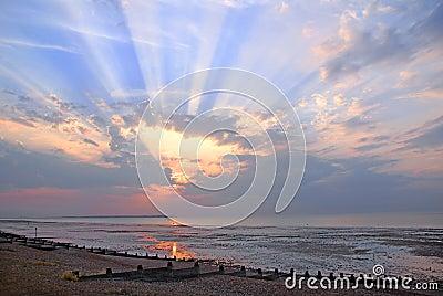 Cloudburst sun rays sunset