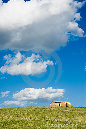 Clouds above a farm on the hill