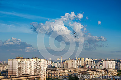 Clouds on blue sky in cityscape.