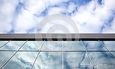 Clouds and blue sky reflected in windows
