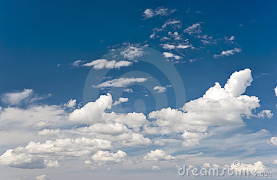 Clouds and flying airplane