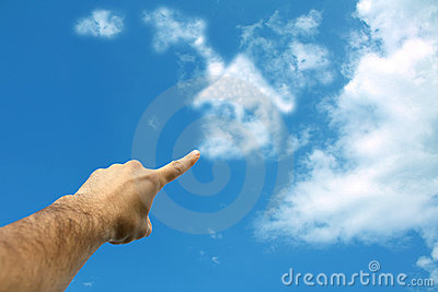 Clouds forming house in sky