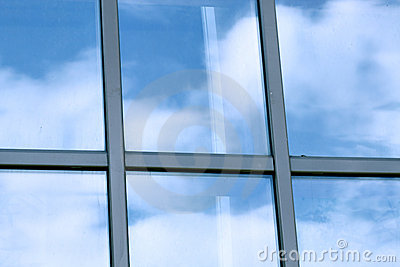 Clouds in glazed panel skyscraper