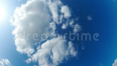 Clouds Move Smoothly in the Blue Sky with Fisheye effect. Timelapse. Sunny blue sky, white, and gray clouds. Beautiful clouds flying in the air. Time lapse stock footage