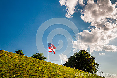 Clouds over an American flag on Federal Hill