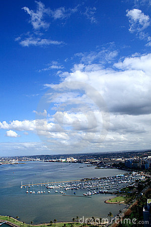 Free Clouds Over Coastal City Royalty Free Stock Images - 5082349