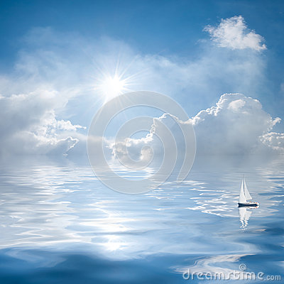 Clouds and sun reflection in water