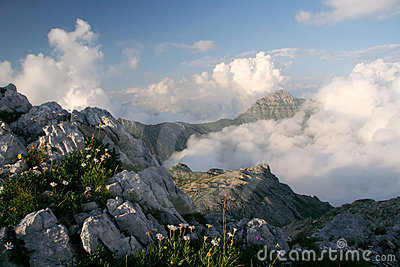Clouds under mountains
