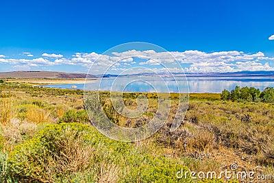 Cloudscape over blue lake