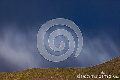 Cloudscape over hillside